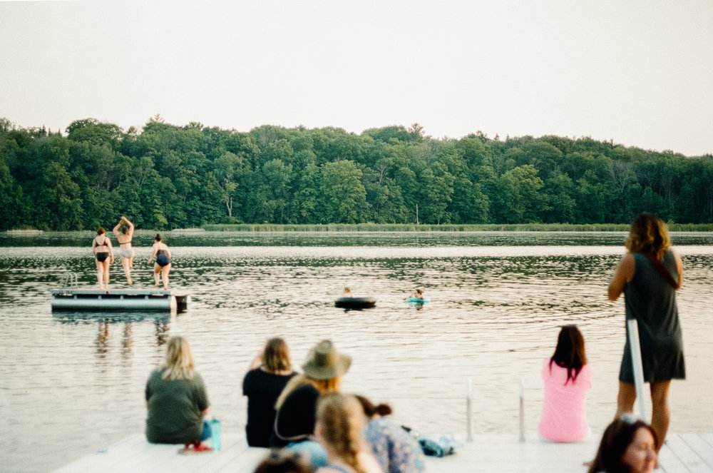 A photo of women swimming in the lake at  Camp Wandawega  in Elkhorn, Wisconsin during Let's Camp 2018 photographed for  Driftless magazine  and hosted by  The Glossary  and  Feminest .
