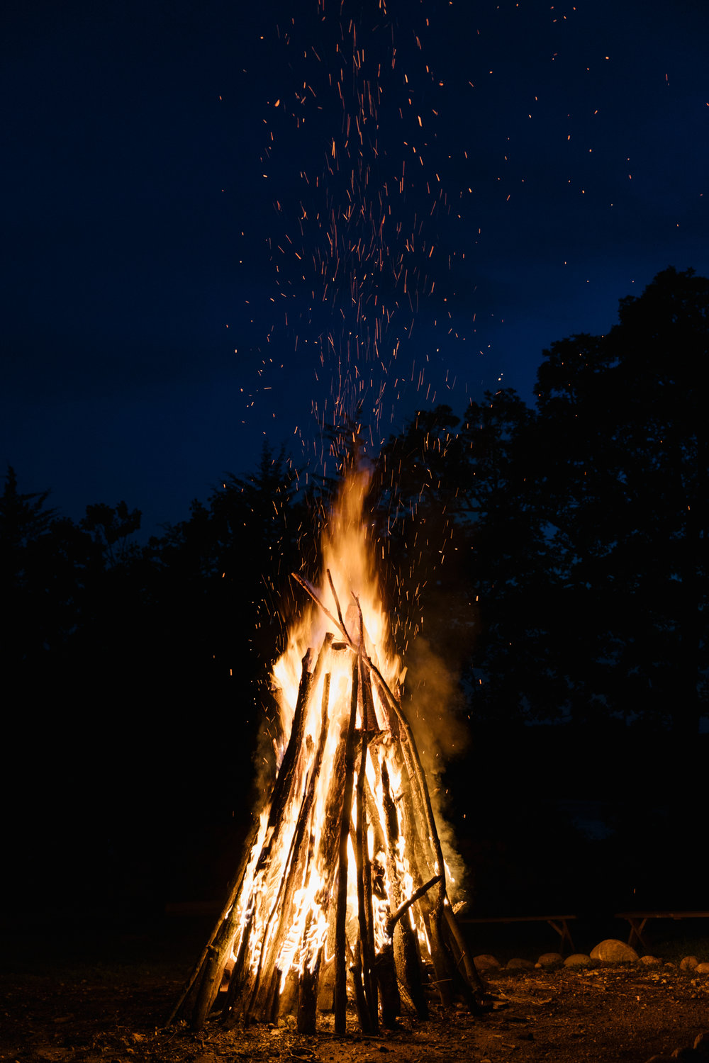 A photo of a giant summer bonfire at  Camp Wandawega  in Elkhorn, Wisconsin during Let's Camp 2018 photographed for  Driftless magazine  and hosted by  The Glossary  and  Feminest .