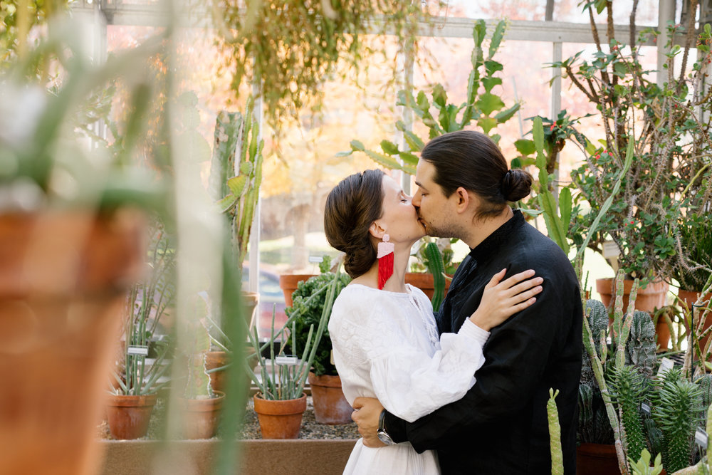A portrait of a bride and groom in the Jordan Greenhouse on their wedding day at Indiana University in Bloomington, Indiana.