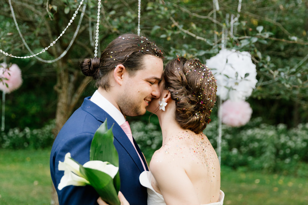 A photo of a bride and groom during their wedding ceremony during their intimate, summer wedding in Bloomington, Indiana.