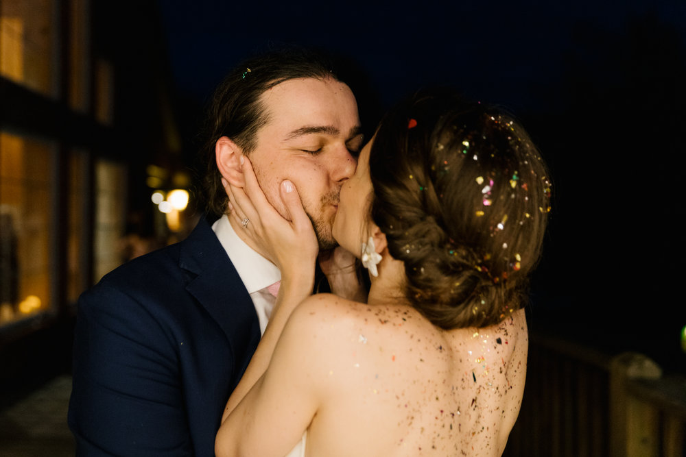 A portrait of a bride and groom kissing during their wedding reception at their intimate, summer wedding in Bloomington, Indiana.