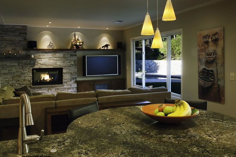 The cook can keep an eye on the family room from the island.
