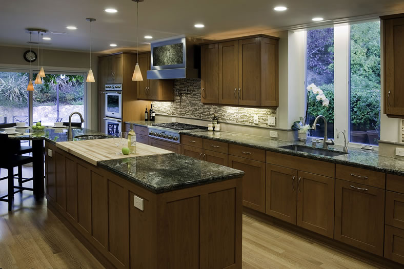 This kitchen's lighting is functional and can set a mood.