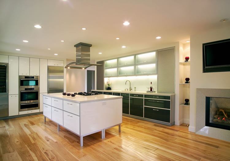 Hand Hewn Hickory Floors Are The Rustic Counterpoint To This Modern Kitchen.