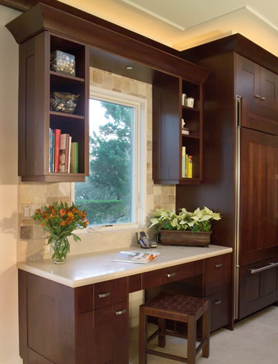 The integrated kitchen desk acts as the homes message center.