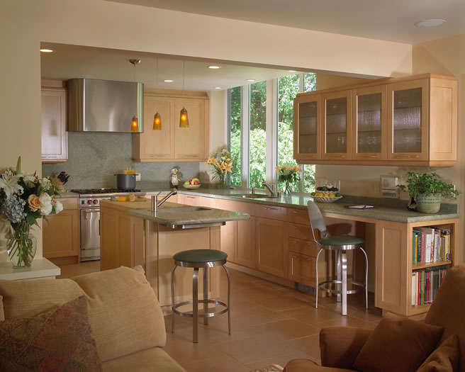 The large window and natural maple cabinetry makes this kitchen light and bright.