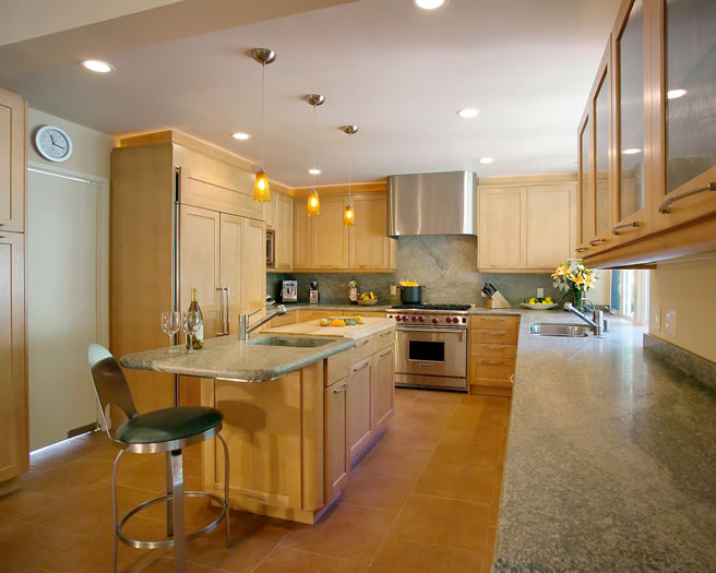 Ample honed granite counters, butcher block island, and professional appliances are a cooks dream.