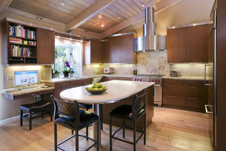 The warmth of this kitchen comes from the rich cherry cabinetry and honed stone surfaces.