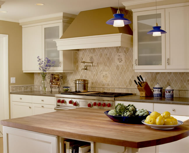 The large cherry chopping block island is the center of activity for this kitchen.