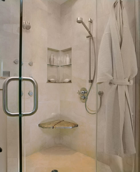 His/Hers shampoo niche with a floating seat.