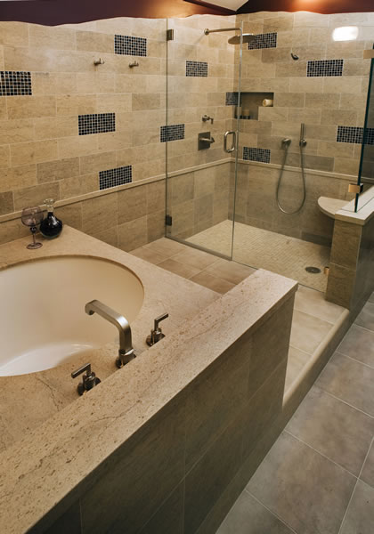 Brushed nickel fixtures accent the Asian soaking tub and large shower.