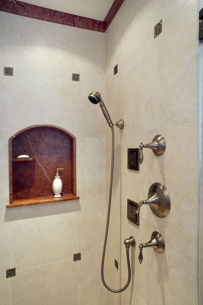Custom marble niche and molding with metallic accent tiles.