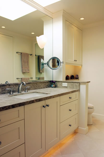 Honed stone surfaces and clean lines make this bath comfortable.