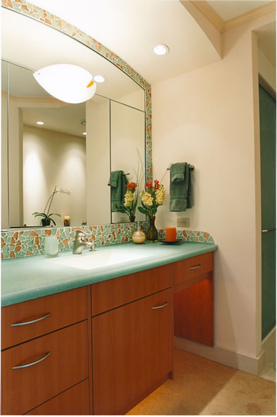 A recycled glass tile splash frames the mirror.