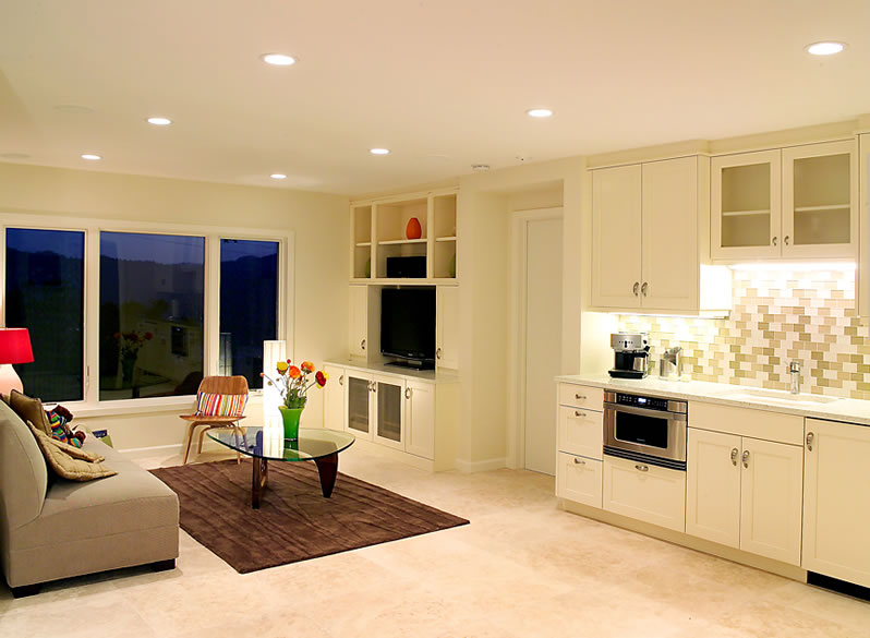 A guest suite sitting area with kitchenette.
