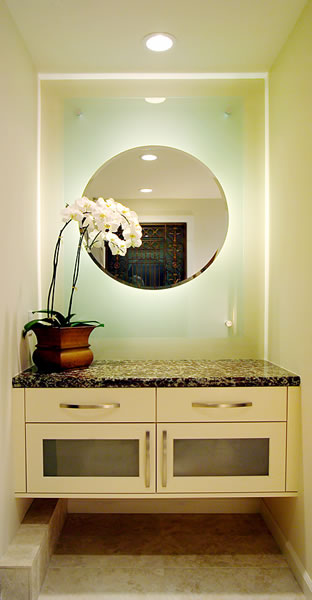 An entry counter with floating backlit mirror.
