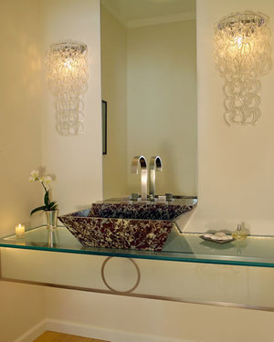 Custom marble sink on etched glass counter.