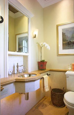 Custom limestone slab work is throughout this bath.