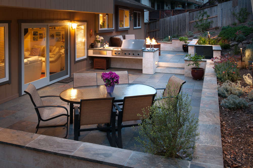 An entertaining space with slate deck surface .