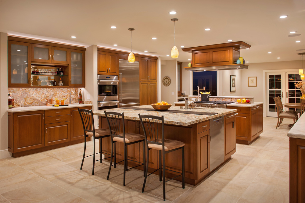 A fully appointed kitchen including a wet-bar.