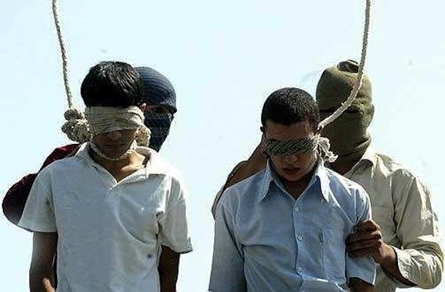 Mahmoud Asgari age 16, and Ayaz Marhoni age 18, being prepared for execution by hanging in the Islamic Republic of Iran, on July 19, 2005.