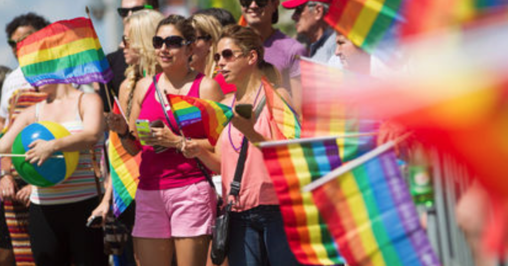 Revellers take part in the Ottawa Pride Parade on Bank Street, August, 24, 2014. Over 75,000 people were said to take part in the days festivities. (Chris Roussakis/Ottawa Sun)