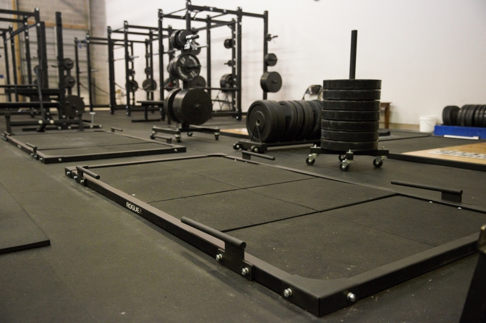Two deadlift platforms with band pegs.