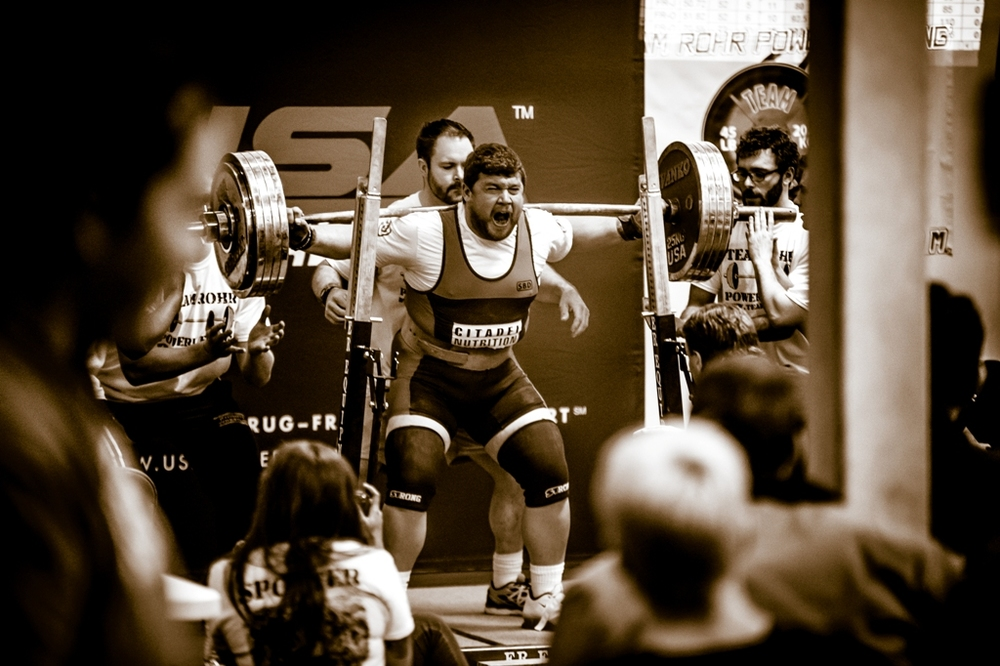 Citadel Nutrition Athlete Ross Tyner squatting 566#
