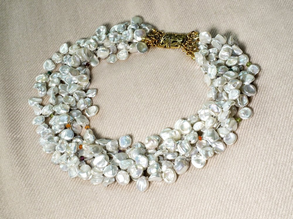 Seven-strand silvery-white nugget pearl collar, each strand dotted with assorted sapphire, chalcedony, and quartz gemstones, and closed with elegant 24K vermeil clasp. Length 16-17 inches.
