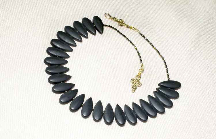 Elegant matte black onyx teardrops lay flat on the neck, surrounded by the sparkle of small faceted black spinnels, and closed with a slender vermeil hook clasp. Length 17 ½ inches. Materials:  black onyx, faceted black spinnels,  vermeil  ID #N1718218