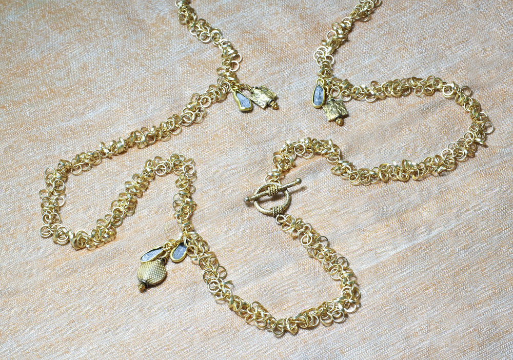 Be charmed with this unusual double wrap-around 24K vermeil multi-link chain necklace with antique Roman glass charms paired with vintage gold plate charms pendants framed and closed with easy vermeil hook clasp and adjustable chain. Length 35 inches.  Materials: vermeil, antique Roman glass, vintage gold plate