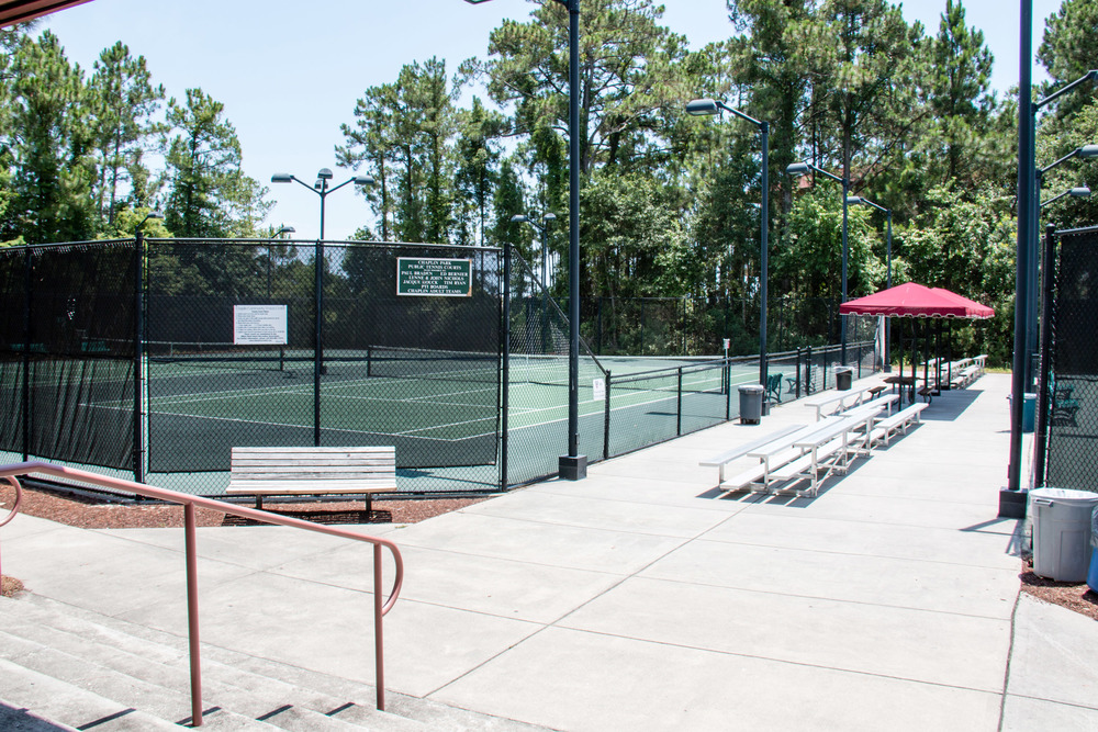 four courts located in front of tennis main building