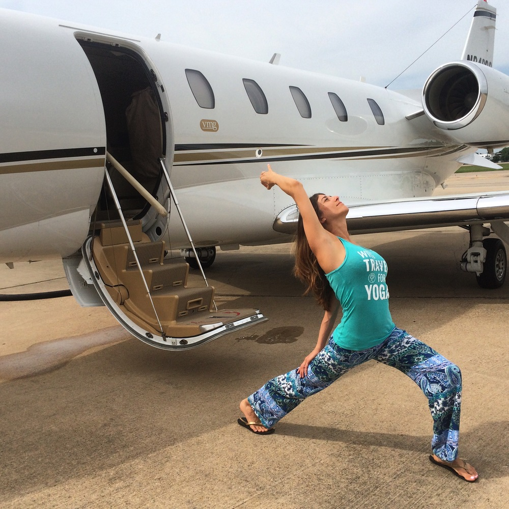 "Outside the jet, doing my #Stopdropandyoga, reppin' my @yogatraveltree ""Will Travel For Yoga"" tank - a staple on my journeys!"