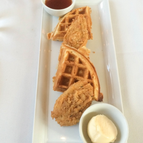 "Warm maple spicy syrup drizzled over tender pieces of ""chicken"" and soft waffles.. slathered in cashew butter. My kind of vegan heaven."