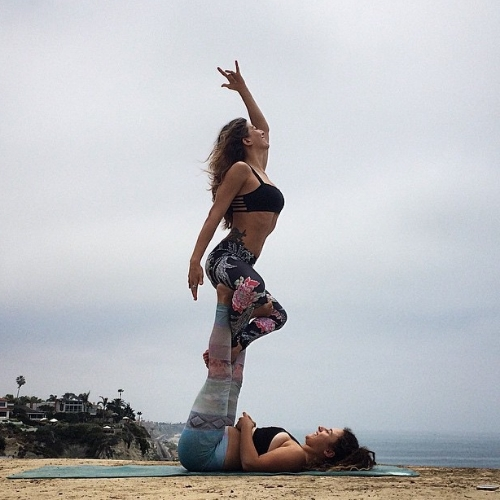 We used my tripod and bluetooth remote to capture this photo. Yogis: @rima_danielle & @yogawithjoelle in San Clemente, California. July 2015.