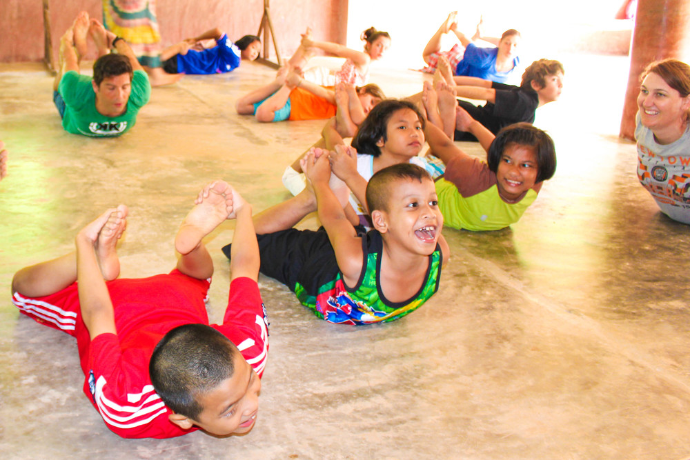 The children of TCDF doing yoga during Saturday Creative School for local children in the community.
