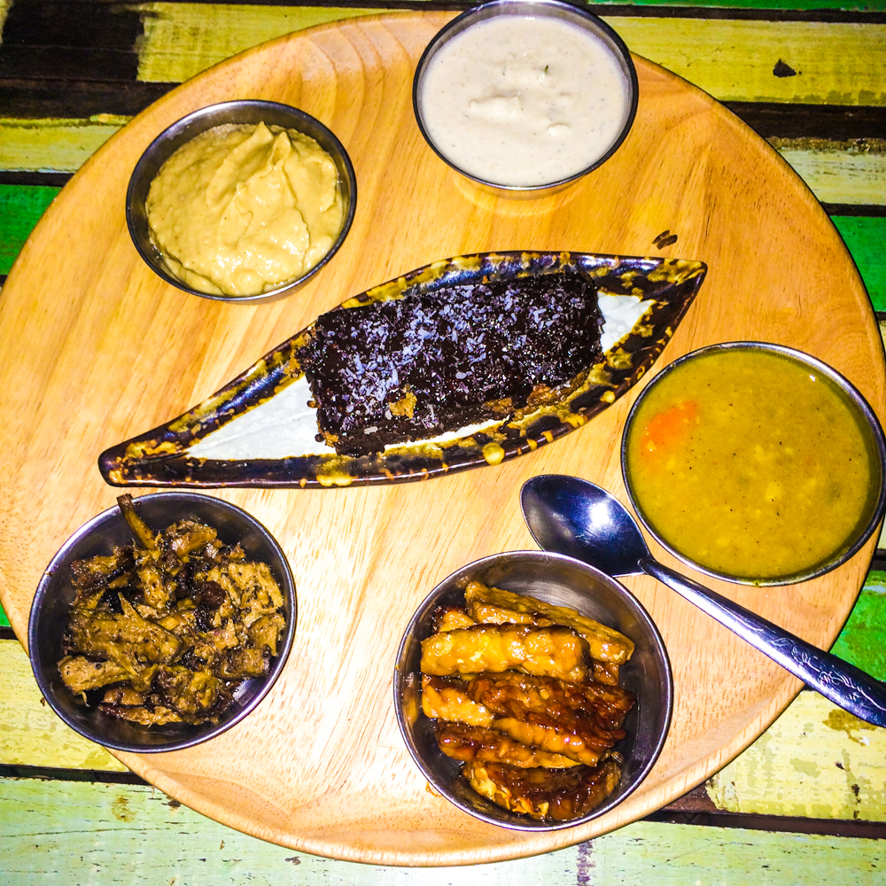 The large thali is a sampler of their different items, so you never know what you'll get! Here we have the spicy mango hummus, the mushroom kebabs, the marinated tempeh, the Dal-of-the-day, and a slice of banana chocolate cake for dessert (the top white is a garlic & chives cashew cheese dipping sauce).