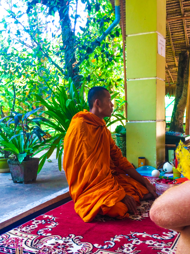 The beautiful monk that came to bless and bathe us at Vagabond Temple.