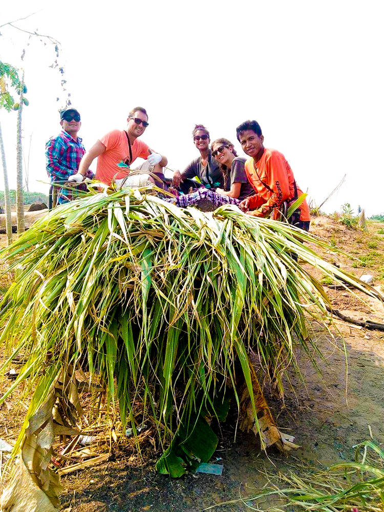 Stan, Pete, Jessica (fellow volunteer), me & Pheakday with our load of sugar cane and banana leaf trees.