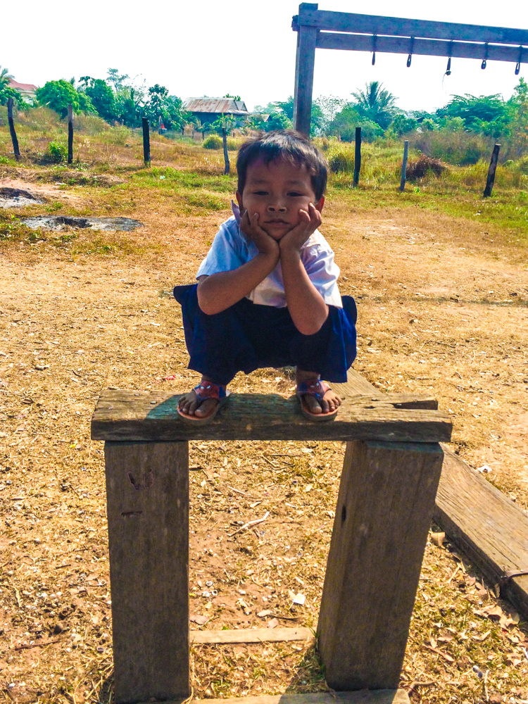 A boy hangs out during recess and a school in rural Cambodia.