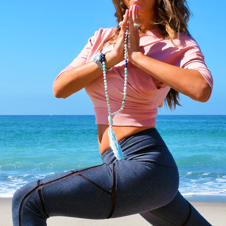 Wearing Malabella Jewels Mala and outfit by Karma Athletics ( Look 1 in The Fashion of Yoga 5 ).