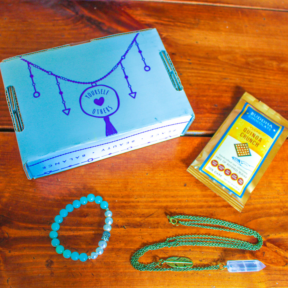 "The Yogi Surprise ""Jewelry Box"" comes with two pieces of jewelry and a piece of chocolate each month!"