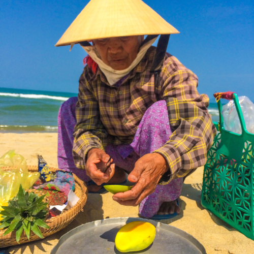 Fresh, delicious mango from a local Vietnamese woman on An Bang Beach near Hoi An, Vietnam.