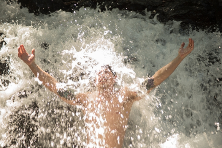 David, our retreat guest from November, enjoying a fresh water, energizing bath in the waterfalls.