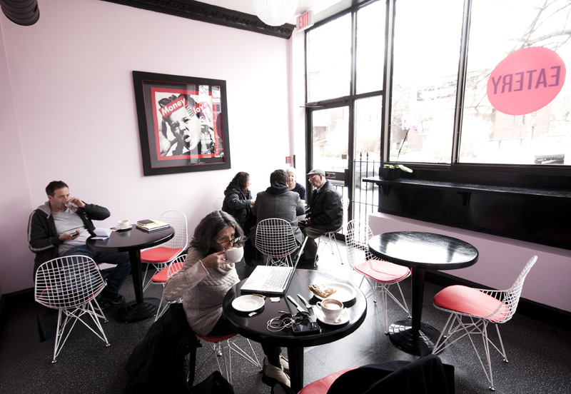 People drink their cappucinos at Baked on Lauder a a cafe in the north west end of Toronto
