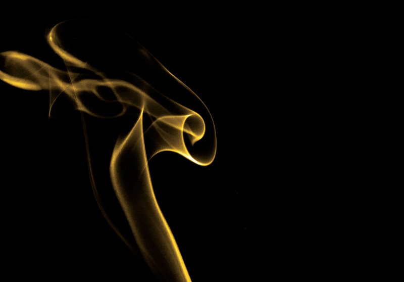 Yellow smoke on a black background shot in the studio