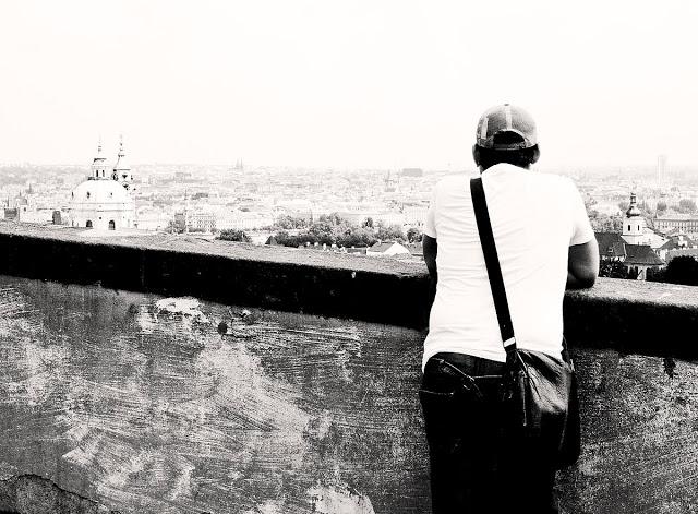 A tourist observing the Prague skyline