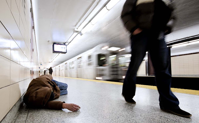 A homeless man sleep on the TTC subway at Christie station.