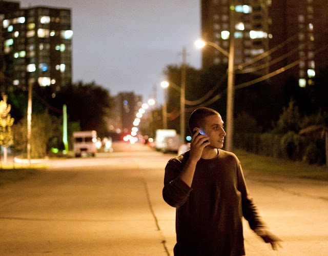 Marco on the phone at night at the top of richview shot by Dennis Marciniak