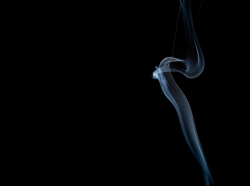 Smoke smoke on a black background